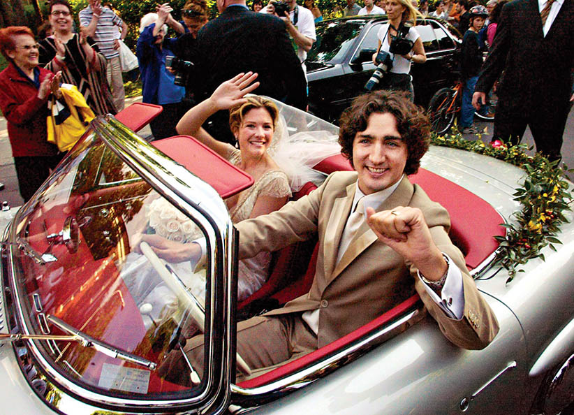 FOR USE AS DESIRED WITH DECADE END STORIES OR AS A STAND-ALONE PHOTO PACKAGE FILE - Justin Trudeau, son of the late Prime Minister Pierre Trudeau, leaves with his new bride Sophie Gregoire in his father's 1959 Mercedes 300 SEL after their marriage ceremony in Montreal Saturday, May 28, 2005.(RYAN REMIORZ/CP)