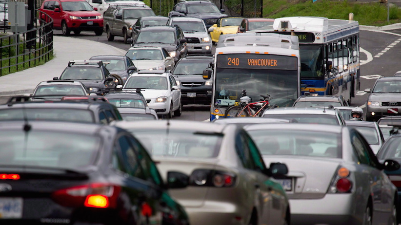 Motorists merge from four lanes into one as they enter the Lions Gate Bridge to drive into Vancouver, B.C., on July 15, 2011. Traffic congestion in most major Canadian cities is getting worse, according to a traffic index compiled by a firm that specializes in navigation and mapping products. TomTom's fifth annual traffic index suggests the average commuter lost 84 hours in 2014 while delayed in traffic in Toronto, Vancouver and Montreal. THE CANADIAN PRESS/Darryl Dyck