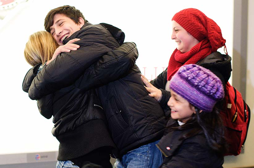 Tima Kurdi (L), embraces her nephew Chergo Kurdi as her nieces Haveen Kurdi (top R), and Ranim Kurdi rush towards her at Vancouver International airport in Vancouver, British Columbia, December 28, 2015. The Kurdis' brother, Abdullah and his family, tried to make the crossing from Turkey to Greece on an overcrowded boat. It capsized, and his wife and children drowned. The horrific image of three-year-old Alan's death became an iconic symbol of the plight of Syrian refugees and a major issue in the Canadian federal election. (Jimmy Jeong/Reuters)