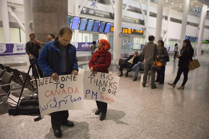 Well-wishers gather in the hope of greeting Syrian refugees arriving on the first government arranged flight at Toronto's Pearson Airport, on Thursday, Dec. 10, 2015. (Chris Young/CP)