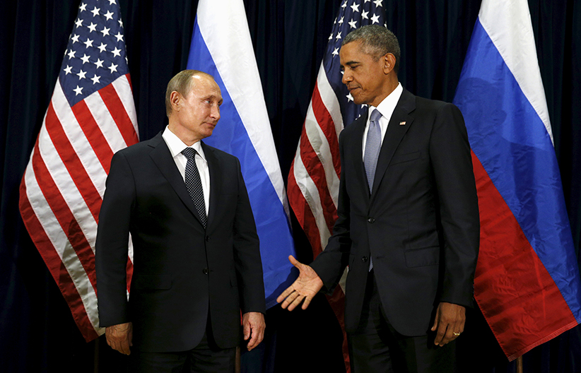 U.S. President Barack Obama extends his hand to Russian President Vladimir Putin during their meeting at the United Nations General Assembly in New York September 28, 2015. (Kevin Lamarque/Reuters)