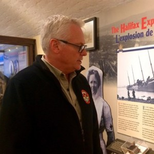 Ken Hynes, curator of the Army Museum at Citadel Hill, looks at a photo of his grandfather, Fletcher Manchester Bartlett, who was working at Citadel Hill at the time of the Halifax Explosion on Dec. 6, 1917. Sunday marked the 98th anniversary of the disaster, which left roughly 25,000 people dead, injured or homeless. (Aly Thomson/CP)