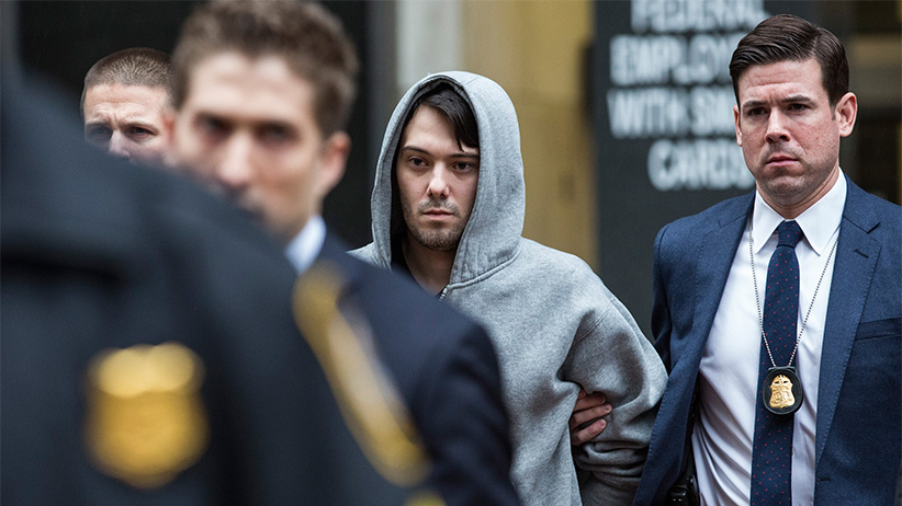 NEW YORK, NY - DECEMBER 17:  Martin Shkreli (C), CEO of Turing Pharmaceutical, is brought out of 26 Federal Plaza by law enforcement officials after being arrested for securities fraud on December 17, 2015 in New York City. Shkreli gained notoriety earlier this year for raising the price of Daraprim, a medicine used to treat the parasitic condition of toxoplasmosis, from $13.50 to $750 though the arrest that happened early this morning does not involve that price hike. Andrew Burton/Getty Images