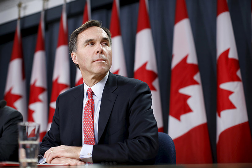 Canada's Finance Minister Bill Morneau at a news conference in Ottawa, Canada, December 7, 2015. The new Canadian government's planned tax hike on the rich will bring in less money than forecast. A government document said the tax hike would bring in C$2.01 billion ($1.49 billion), while the cost of the tax cut would be C$3.44 billion ($2.55 billion). (Chris Wattie/Reuters)