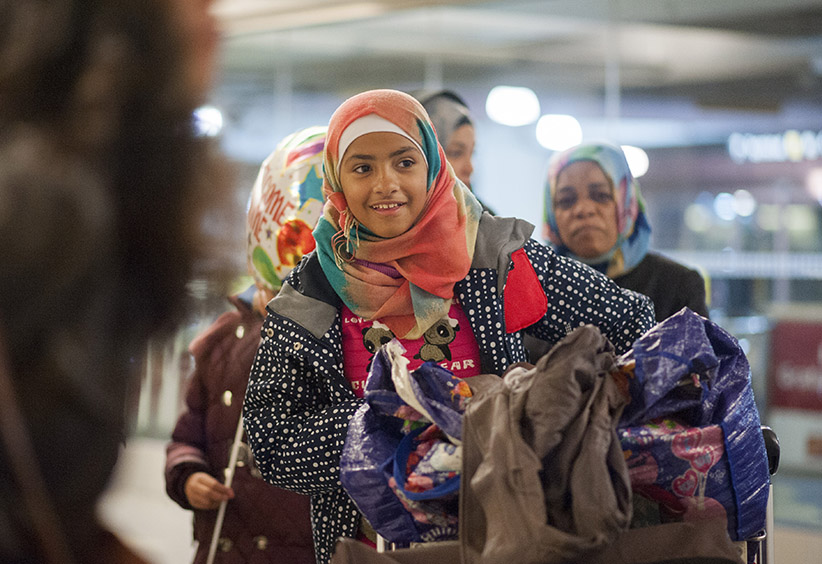 Hanien Falah, a refugee from Syria, walks with her family to the parking lot at the Toronto Pearson International Airport on Thursday, Dec. 10, 2015 after arriving from Frankfurt, Germany. (Photograph by Hannah Yoon)
