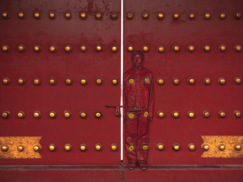 Liu Bolin, Hiding in the City - Red Door, photograph, 2012. (Liu Bolin/Klein Sun Gallery)