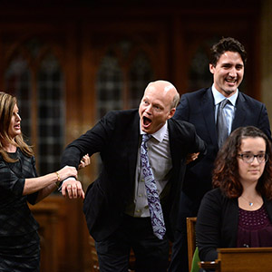 Newly-elected Speaker of the House Geoff Regan, centre, jokingly resists as he's escorted to the speaker's chair by Conservative interim leader Rona Ambrose, left, and Prime Minister Justin Trudeau in the House of Commons on Parliament Hill in Ottawa on Thursday, Dec. 3, 2015. (Sean Kilpatrick/CP)