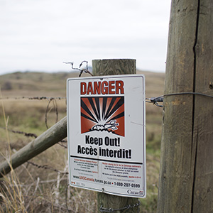 A warning sign on the Goose Lake Range in Vernon B.C. , October 27, 2015. Many unexploded explosive ordnance are still on the range which is owned by the Okanagan Indian Band Reserve. (Photograph by Jason Franson)