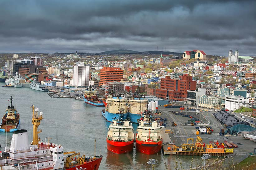 Storm clouds form over the city of St. John's and St. John's busy harbour. (V. J. Matthew/Shutterstock)