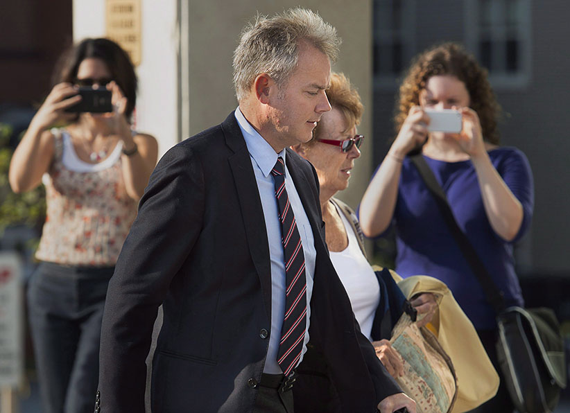 Dennis Oland, accompanied by his mother Constance Oland, arrives for the start of his trial in Saint John, N.B. on Wednesday, Sept. 16, 2015. Oland is charged with second degree murder in the death of his father. Richard Oland, 69, was found dead in his Saint John office on July 7, 2011. (Andrew Vaughan/CP)