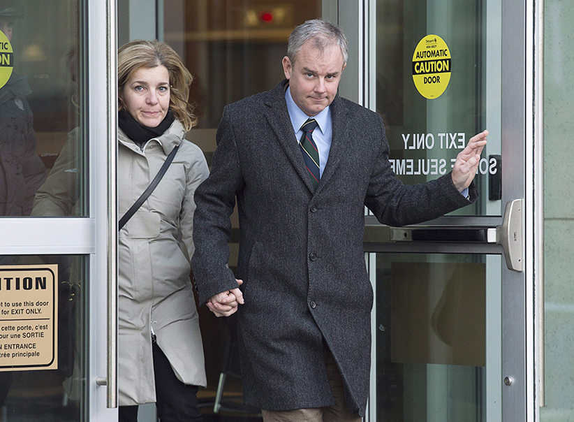 Dennis Oland and his wife Lisa head from the Law Courts as the jury begins their deliberations at his murder trial in Saint John, N.B. on Wednesday, Dec. 16, 2015. Oland is charged with second degree murder in the death of his father, Richard Oland, who was found dead in his Saint John office on July 7, 2011. Andrew Vaughan/CP