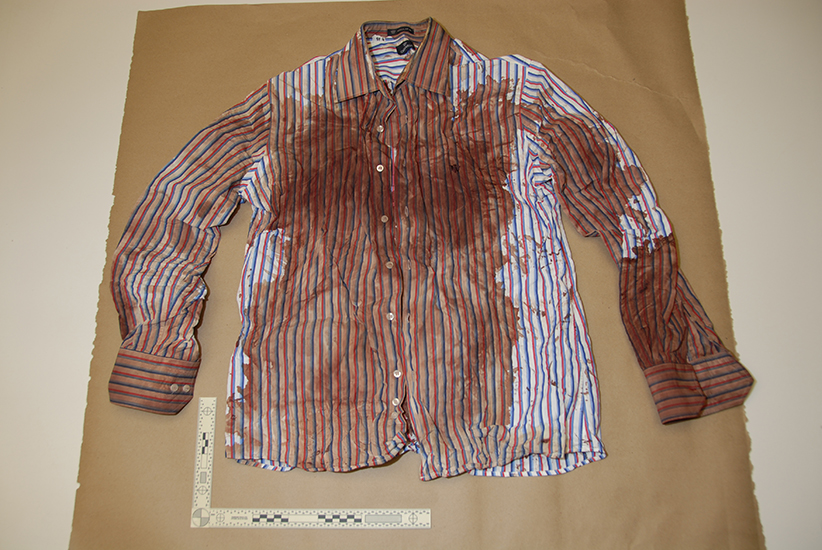 This is photo 92 of Exhibit P-70. A photo of Richard Oland's bloody shirt as evidence in Dennis Oland's trial. Court exhibit.