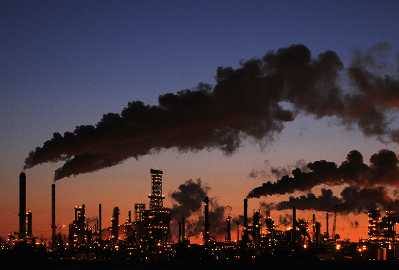 Petro-Canada's Edmonton Refinery and Distribution Centre glows at dusk in Edmonton. (Dan Riedlhuber/Reuters)