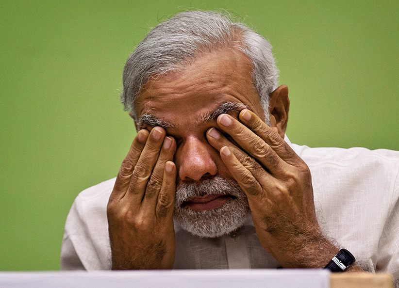 FILE- In this April 6, 2015 file photo, India's Prime Minister Narendra Modi rubs his eye as he attends a conference by the environment ministry in New Delhi, India. Modi is facing a revolt within his Hindu nationalist party by senior leaders questioning his leadership style after the recent debacle in state elections. (Saurabh Das/AP)