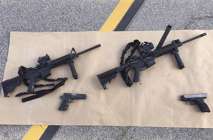 Weapons confiscated from last Wednesday's attack in San Bernardino, California are shown in this San Bernardino County Sheriff Department handout photo from their Twitter account released to Reuters December 3, 2015.  (San Bernardino County Sheriffs Department/REUTERS)