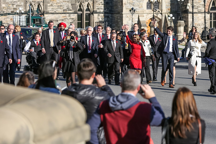 Prime Minister Justin Trudeau and his cabinet arrive at Parliament Hill for their first Cabinet meeting after being sworn-in earlier in the day. November 4, 2015. (Prime Minister's Office)