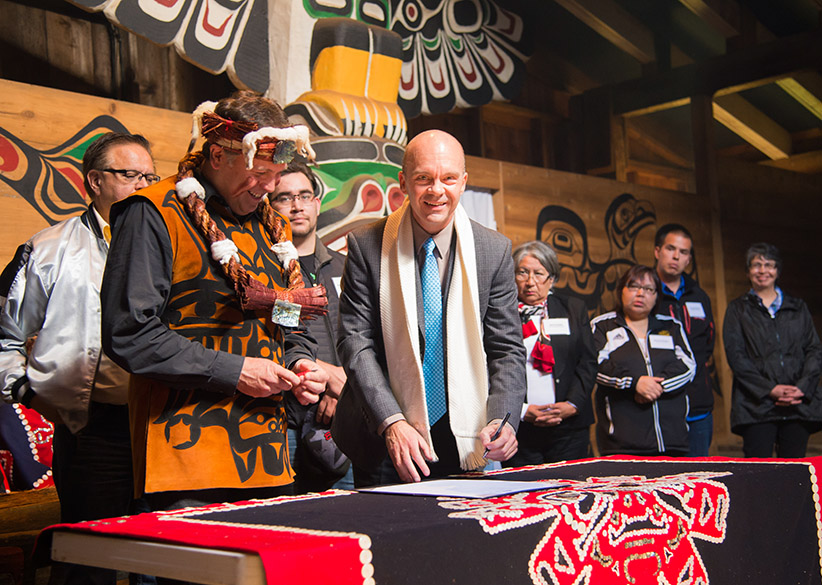 Signing Protocol. The man on the left is Robert Everson, K'ómoks First Nation Chief Councillor. The man on the right is John Bowman, President, North Island College. (Lee Simmons/North Island College)