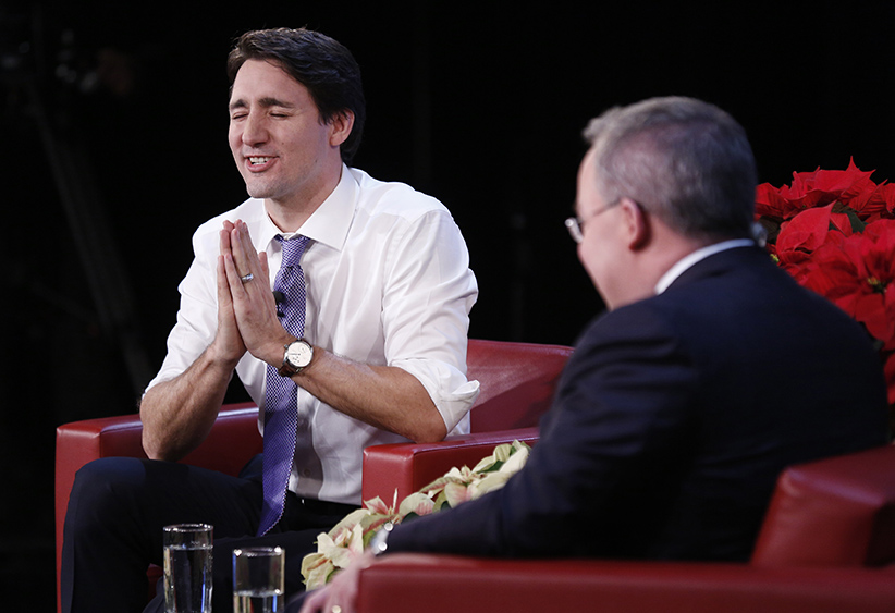 Canada's Prime Minister Justin Trudeau speaks with Maclean's Magazine political writer Paul Wells at the National Arts Centre in Ottawa December 16, 2015. (Photograph by Blair Gable)