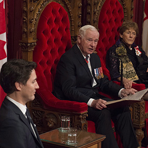 Prime Minister Justin Trudeau and Sharon Johnston listen as Governor General David Johnston delivers the speech from the throne in the Senate Chamber on Parliament Hill in Ottawa, Friday December 4, 2015. THE CANADIAN PRESS/Sean Kilpatrick