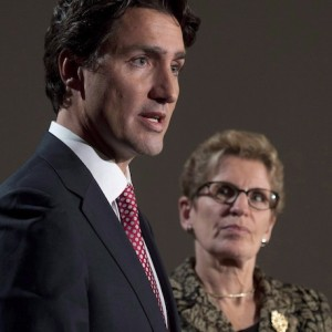 Liberal Leader Justin Trudeau and Ontario Premier Kathleen Wynne take part in a joint news conference in Ottawa, Thursday, January 29, 2015 ahead of a meeting of Canadian premiers. Wynne says she would drop the idea of creating a provincial pension plan if Trudeau becomes the next prime minister. THE CANADIAN PRESS/Adrian Wyld