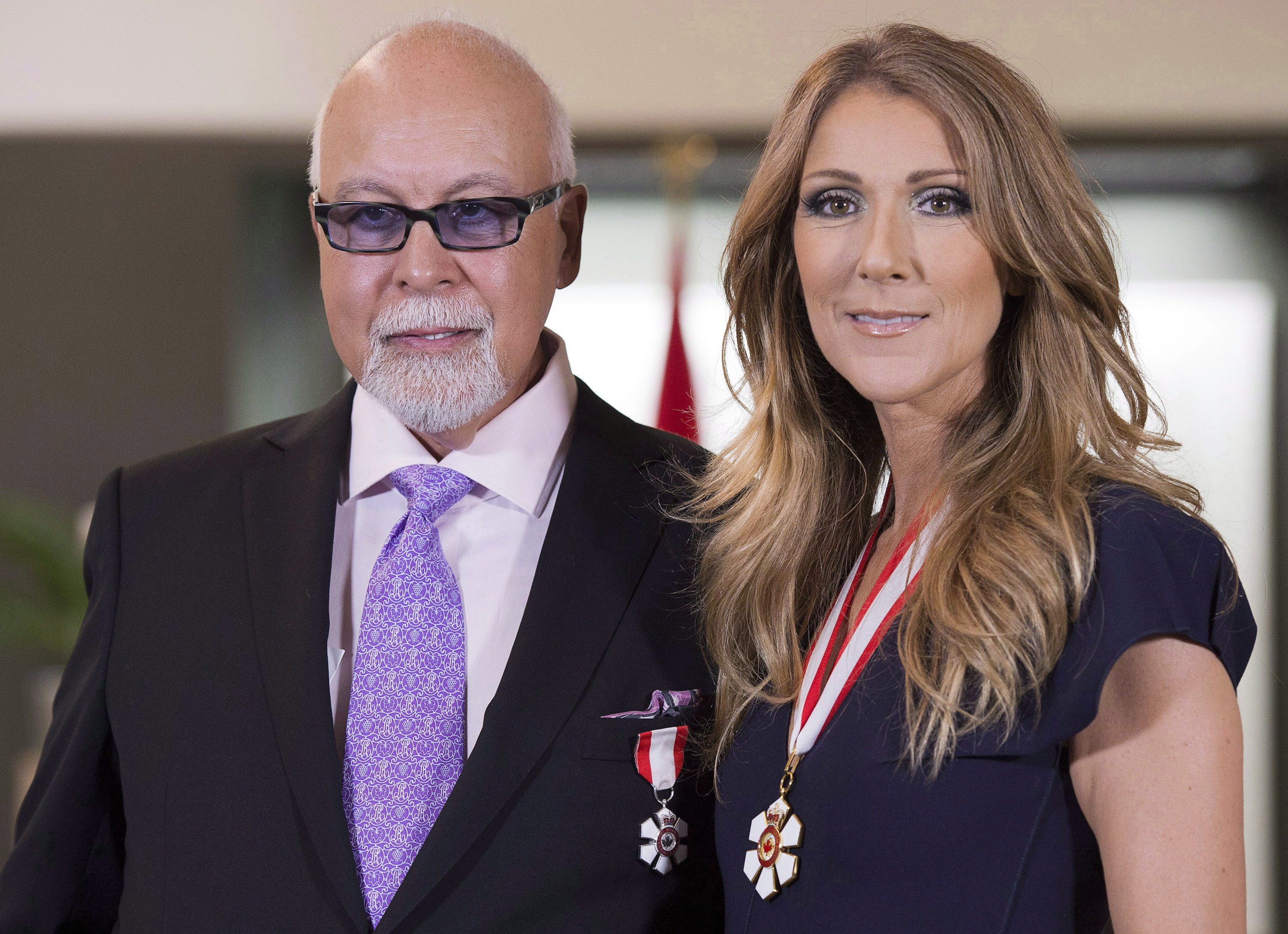 Celine Dion and husband Rene Angelil pose for photos after being decorated with the Order of Canada in Quebec City on Friday, July 26, 2013. Angelil, the entertainment maestro who guided Celine Dion to superstardom and then married her, has died, according to Francine Chaloult, a spokeswoman for Dion. THE CANADIAN PRESS/Jacques Boissinot