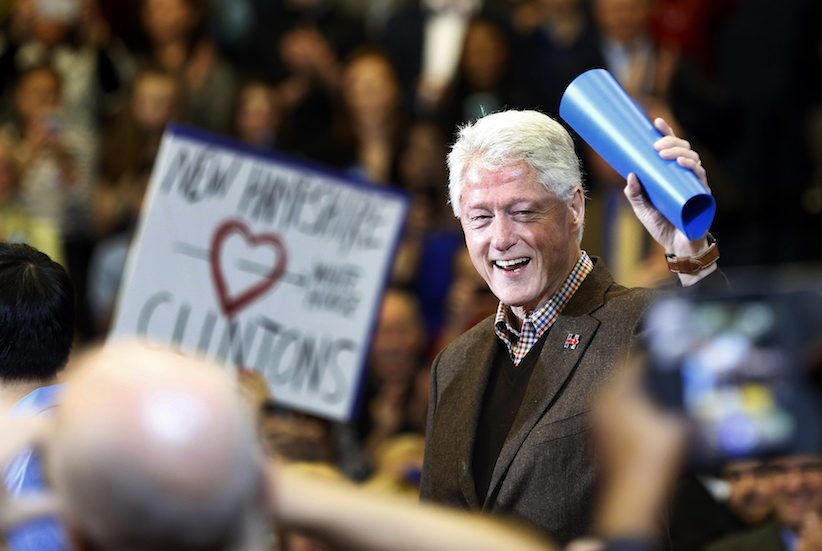 Former President Bill Clinton waves to a cheering crowd as he arrives during a campaign stop for his wife, Democratic presidential candidate Hillary Clinton, Monday, Jan. 4, 2016, in Nashua, N.H. (AP Photo/Jim Cole)