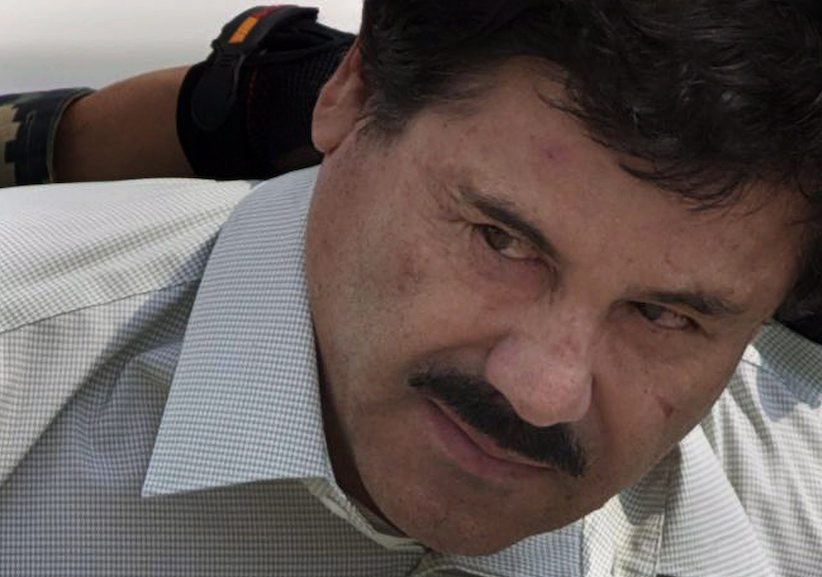 "In this Feb. 22, 2014 file photo, Joaquin ""El Chapo"" Guzman is escorted to a helicopter in handcuffs. (AP Photo/Eduardo Verdugo, File)"