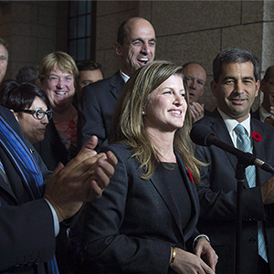 Surrounded by members of caucus, Rona Ambrose speaks after being named as the interim-leader of the Conservative party following a caucus meeting Thursday November 5, 2015 in Ottawa. Adrian Wyld/CP;