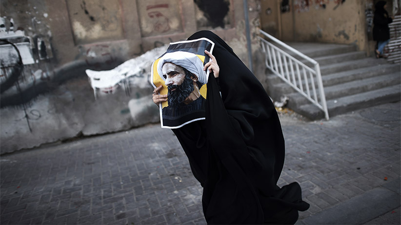 A Bahraini woman holds a poster bearing a portrait of prominent Shiite Muslim cleric Nimr al-Nimr during a protest against his execution by Saudi authorities, in the village of Jidhafs, west of the capital Manama on January 3, 2016. Iraq's top Shiite leaders condemned Saudi Arabia's execution of Nimr, warning ahead of protests that the killing was an injustice that could have serious consequences. (Mohammed Al-Shaikh/AFP/Getty Images)