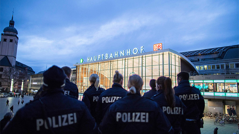 Police officers survey the area in front of the main train station and the Cathedral in Cologne, western Germany, on January 6, 2016, where dozens of apparently coordinated sexual assaults were perpetred against women on New Year's Eve.  MAJA HITIJ/AFP/Getty Images