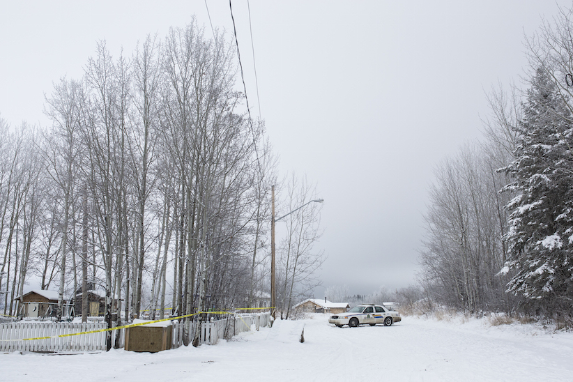 RCMP remain on scene of the house where the bodies of two brothers were found after a shooting last Friday in La Loche, SK. (Photograph by Chris Bolin)