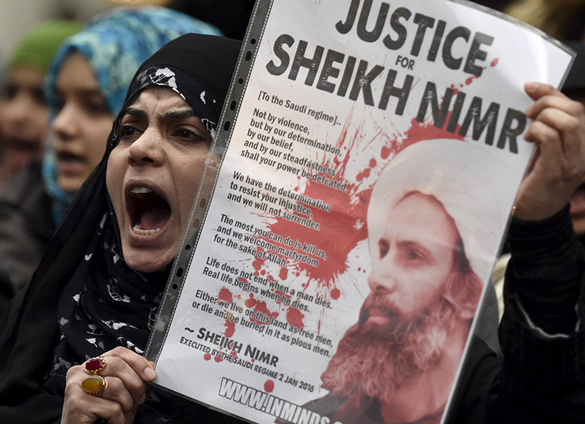 A protester holds a placard during a demonstration against the execution of Shi'ite cleric Sheikh Nimr al-Nimr in Saudi Arabia, outside the Saudi Arabian Embassy in London, Britain, January 3, 2016. (Toby Melville/Reuters)