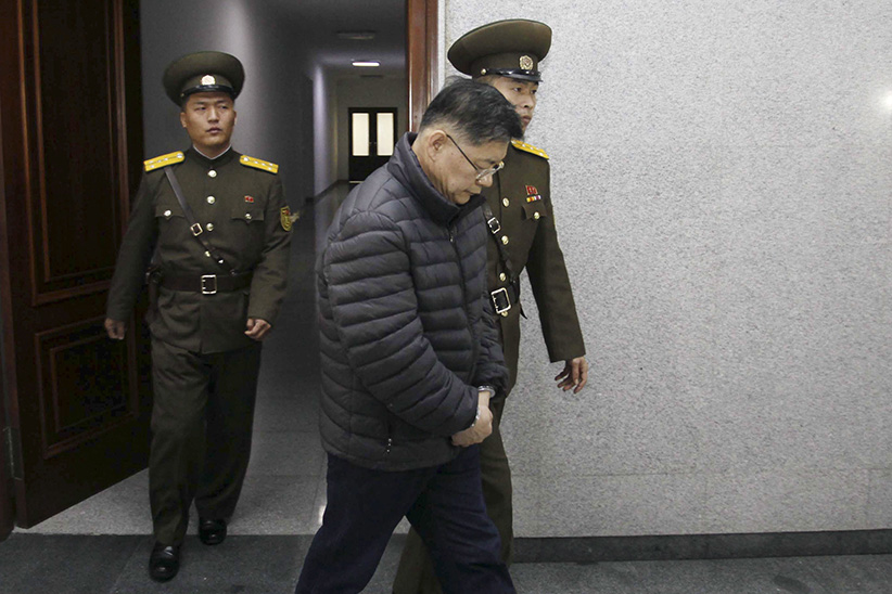 Hyeon Soo Lim, center, who pastors the Light Korean Presbyterian Church in Toronto, is escorted to his sentencing in Pyongyang, North Korea, Wednesday, Dec. 16, 2015. North Korea's Supreme Court sentenced a Canadian pastor to life in prison with hard labor on Wednesday for what it called crimes against the state. (Jon Chol Jin/AP)