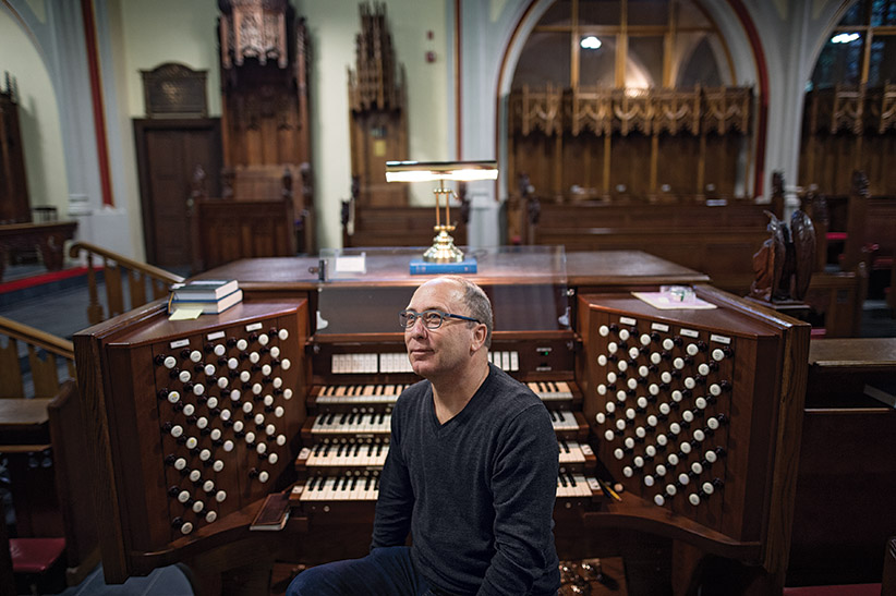 Robert Hiller plays the organ at the Cathedral Church of All Saints in Halifax, NS while tuning the instrument on Thursday, December 17, 2015. (Photograph by Darren Calabrese)