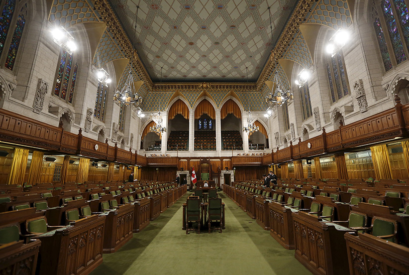 Pages and staff prepare the House of Commons on Parliament Hill in Ottawa, Canada, December 2, 2015.  (Chris Wattie/Reuters)