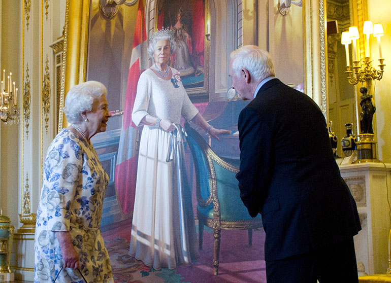 Queen Elizabeth talks with Governor General David Johnston as she unveils a portrait of herself in the White Drawing Room at Buckingham Palace in London on Wednesday, June 6, 2012. The portrait was painted by Canadian artist Phil Richards. (Sean Kilpatrick/CP)