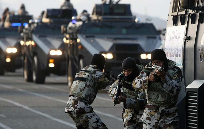 "Saudi special security forces show their skills during a military parade at a base near Mount Arafat, southeast of the holy city of Mecca, on November 22, 2009. Saudi Arabia's Interior Minister Prince Nayef bin Abdul Aziz said the kingdom hopes not to have to ""resort to force"" to maintain security for the hajj, in a reference to worries Iranian pilgrims may demonstrate. Hundreds of thousands of pilgrims from across the globe have gathered in the country to perform the pilgrimage in the holy Muslim cities of Mecca and Medina. (Mahmud Hams/AFP/Getty Images)"