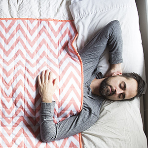 Sleeping with a weighted blanket. This blanket is made by Hippo Hug, a Calgary based company.  (Photograph by Kayla Chobotiuk)