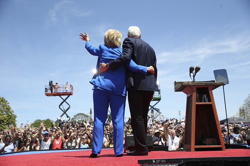Hillary Rodham Clinton is met on stage by her husband, former President Bill Clinton, during a campaign rally on Roosevelt Island in New York, June 13, 2015. Clinton kicked off her 2016 campaign for president on Saturday. (Doug Mills/The New York Times/Redux)