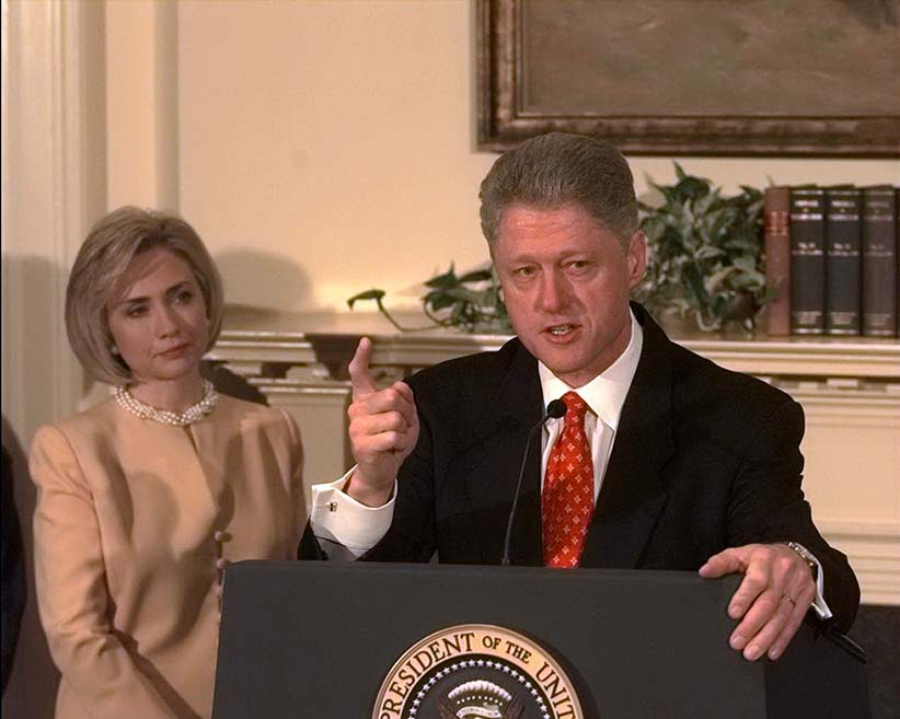 "President Bill Clinton shakes his finger as he denies improper behavior with Monica Lewinsky, in the White House Roosevelt Room. ""I did not have sexual relations with that woman,"" Clinton said. First Lady Hillary Rodham Clinton stands by her man. (Harry Hamburg/NY Daily News/Getty Images)"