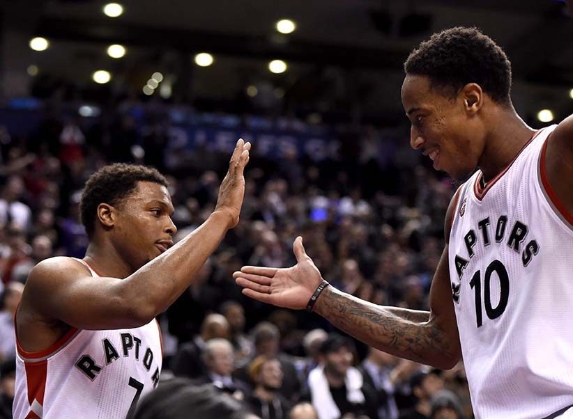 Toronto Raptors' DeMar DeRozan (10) and Kyle Lowry celebrate the dying seconds of their winning game against the Brooklyn Nets following second half NBA basketball action, in Toronto, on Monday, Jan. 18, 2016. (Frank Gunn/CP)