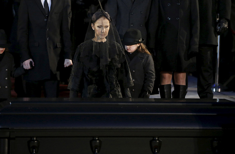 Singer Celine Dion walks up to the casket of her husband Rene Angelil following his funeral at Notre Dame Basilica in Montreal January 22, 2016. (Christinne Muschi/Reuters)