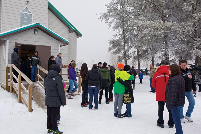 Local residents from La Loche, SK gather in support after attending church in the small community of Northern Saskatchewan on Sunday, January 24, 2016. (Photograph by Chris Bolin)