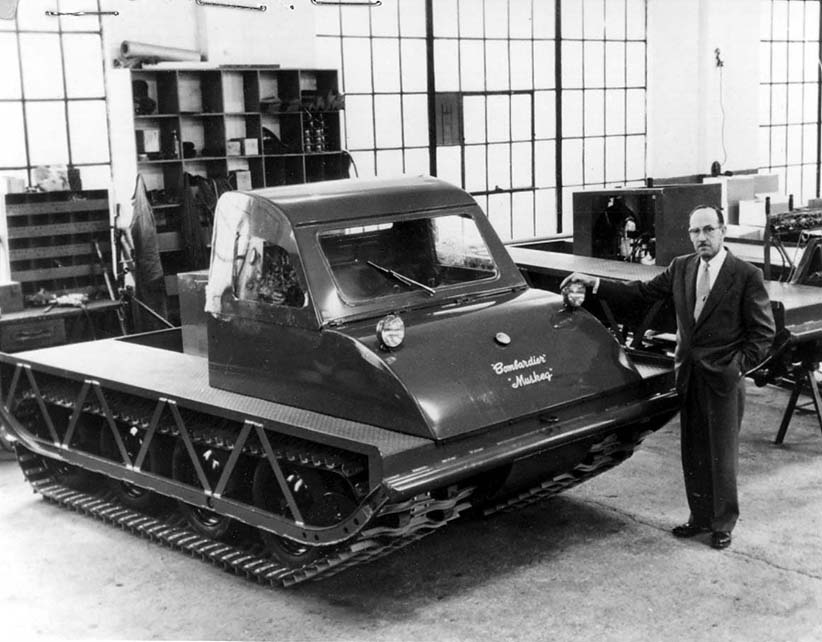J. Armand Bombardier, 52, designer of the Bombardier snowmobile, stands beside the latest model on the production line of his Valcourt, Quebec, factory, 60 miles east of Montreal. (Granby la voix de l'Est/CP)
