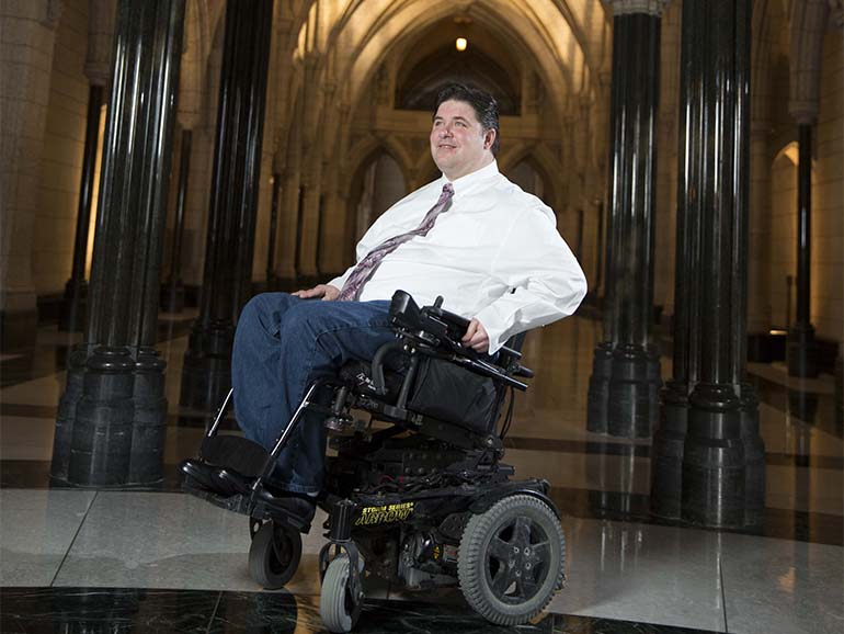 Kent Hehr, Minister of Veterans Affairs and Associate Minister of National Defence, in the Rotunda of Centre Block on Parliament Hill in Ottawa January 22, 2016. (Photograph by Blair Gable)