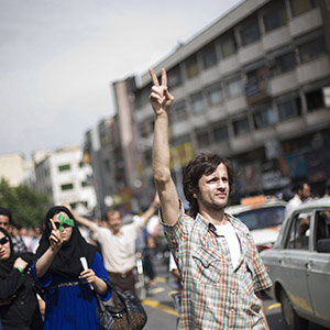 Supporters of opposition leader Mir Hussein Moussavi march in Tehran, Iran, on Monday, June 15, 2009. Hundreds of thousands of people marched in silence through central Tehran on Monday to protest Iran?s disputed presidential election in an extraordinary show of defiance that appeared to be the largest antigovernment demonstration here since the 1979 revolution. (The New York Times)