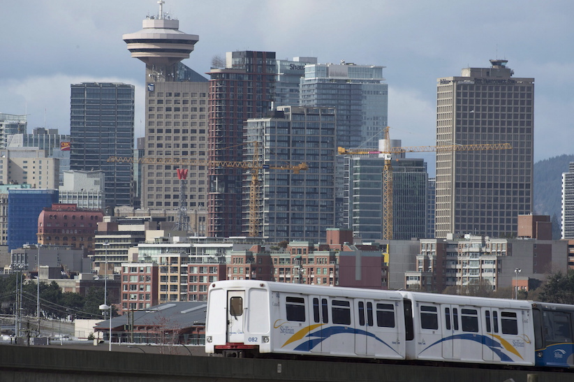 A sky train is pictured in downtown Vancouver, Saturday, March 14, 2015. A unprecedented plebiscite will be asking Metro Vancouver residents if they will be willing to foot the bill for a mega public transportation overhaul. THE CANADIAN PRESS/Jonathan Hayward