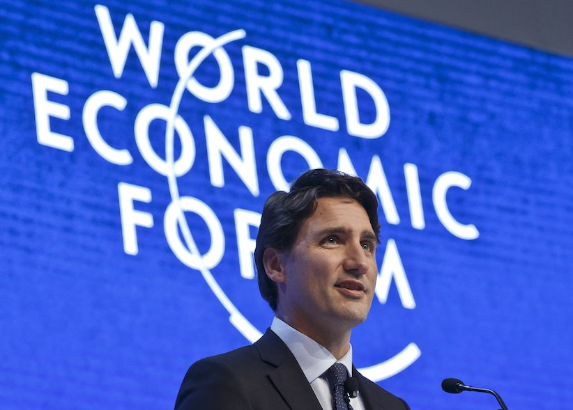 "Canada's Prime Minister Justin Trudeau gestures as he speaks during a panel""The Canadian Opportunity""at the World Economic Forum in Davos, Switzerland, Wednesday, Jan. 20, 2016.  (AP Photo/Michel Euler)"