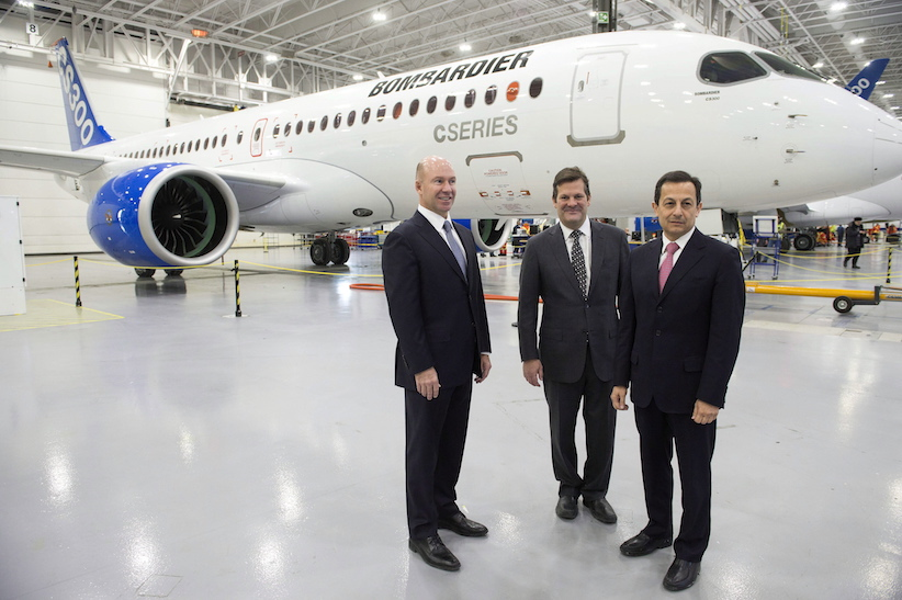 Bombardier CEO Alain Bellemare, left to right, former CEO and executive chairman Pierre Beaudoin and President of Bombardier Commercial Aircraft Mike Arcamone stand in front of a CS300 before it's first test flight in Mirabel, Que., on Friday, February 27, 2015. (Ryan Remiorz/CP)