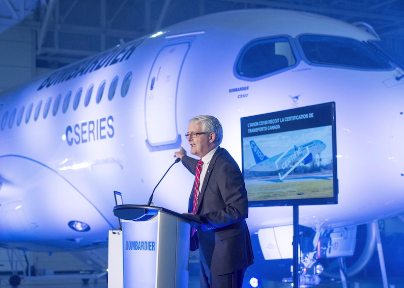 Federal Transport Minister Marc Garneau speaks to staff at Bombardier's CS100 plant Friday, December 18, 2015 in Mirabel, Que. After years of delays and cost overruns, Bombardier's CSeries commercial aircraft has been certified by Canada's transportation regulator. THE CANADIAN PRESS/Ryan Remiorz